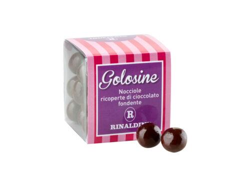 Golosine - nocciole ricoperte di cioccolato fondente